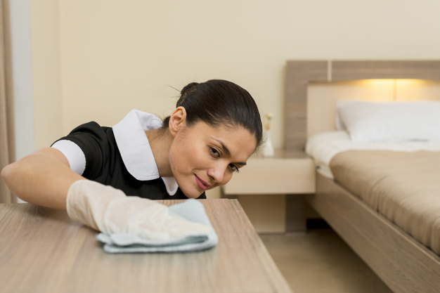chambermaid-cleaning-hotel-room_23-2148095276