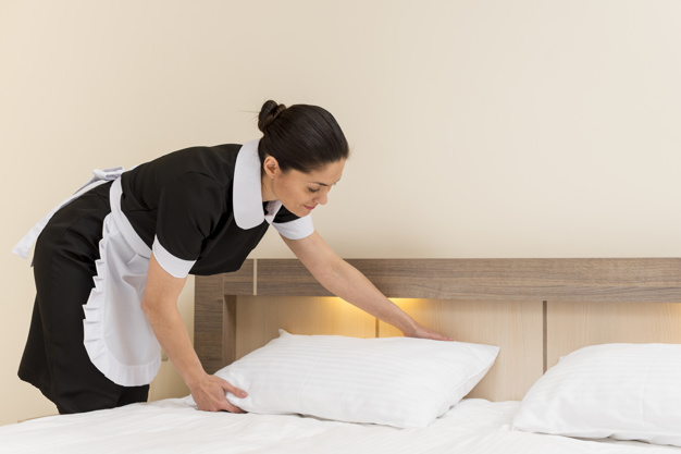 chambermaid-cleaning-hotel-room_23-2148095306