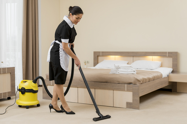 chambermaid-cleaning-hotel-room_23-2148095307